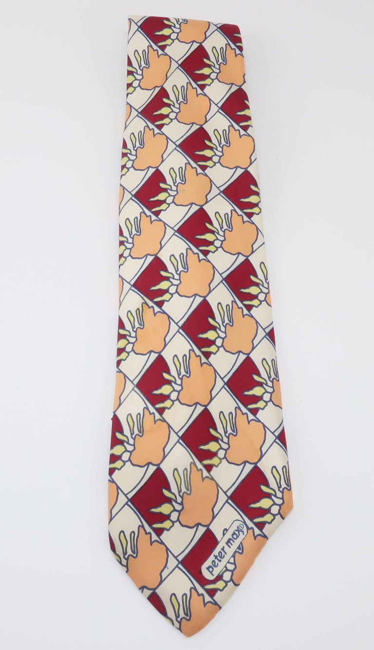 Peter Max made a name for himself in the 1960's by incorporating cultural influences of the psychedelic era into his pop art including wearable art such as this mod Italian silk necktie.  The colorful pattern includes shades of maroon red, blue,