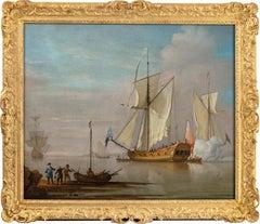 An English Man O' War firing a salute, figures on the shore