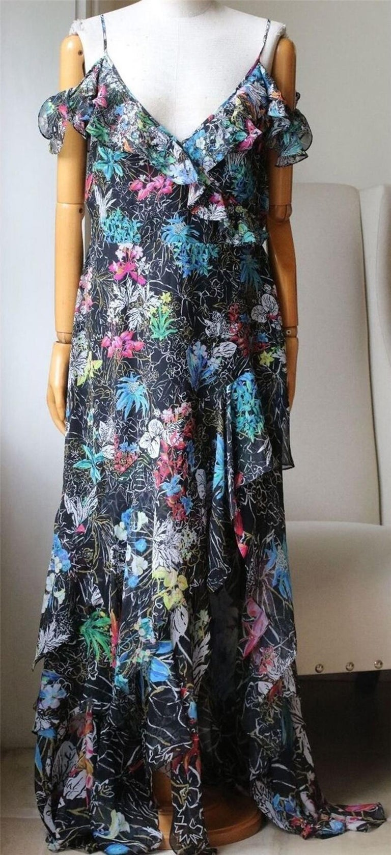 Printed with a dynamic, high-contrast design. Peter Pilotto's silk georgette dress has an evocative feel. Sleeveless for comfortable wear, this maxi-length style comes with ruffled trim at the bust and hem for feminine effect. 100% Silk.   Size: UK