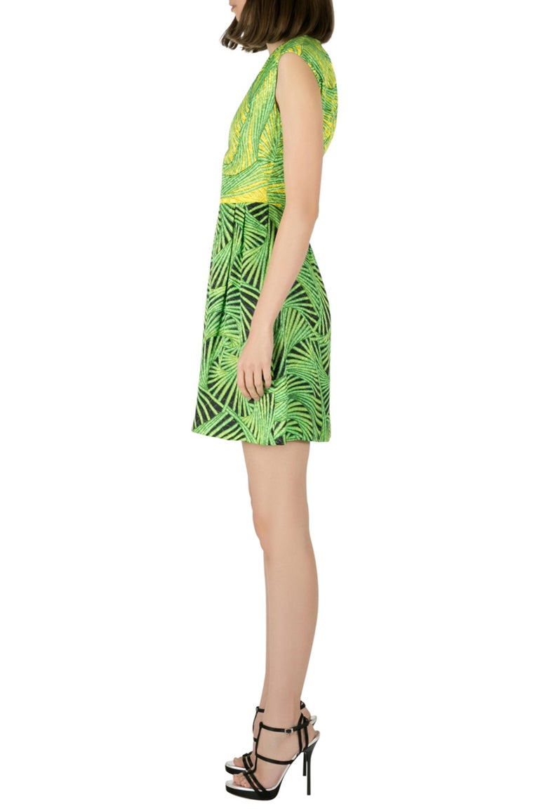 This Peter Pilotto comes in a combination of green and yellow color printed pattern. The sleeveless dress is tailored from silk and has a charming appeal. With strappy heels, it will look great for a day out event.  Includes: The Luxury Closet