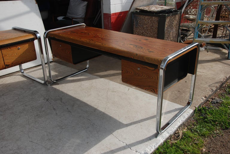 Desk designed by Peter Protzmann for Herman Miller in the 1970s. This was a limited production run. Made from exotic African zebra-wood and supported by a chrome frame and 2 file drawers plus a center pencil drawer.