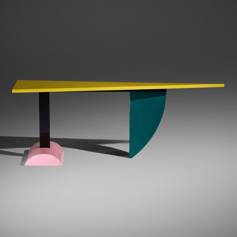 Peter Shire (b. 1947)  An exceptionally imaginative and dynamic architectural console, dining table, and desk by Peter Shire for Ettore Sottsass' Memphis Group. A striking interplay of geometric forms in lacquered wood, this asymmetric,