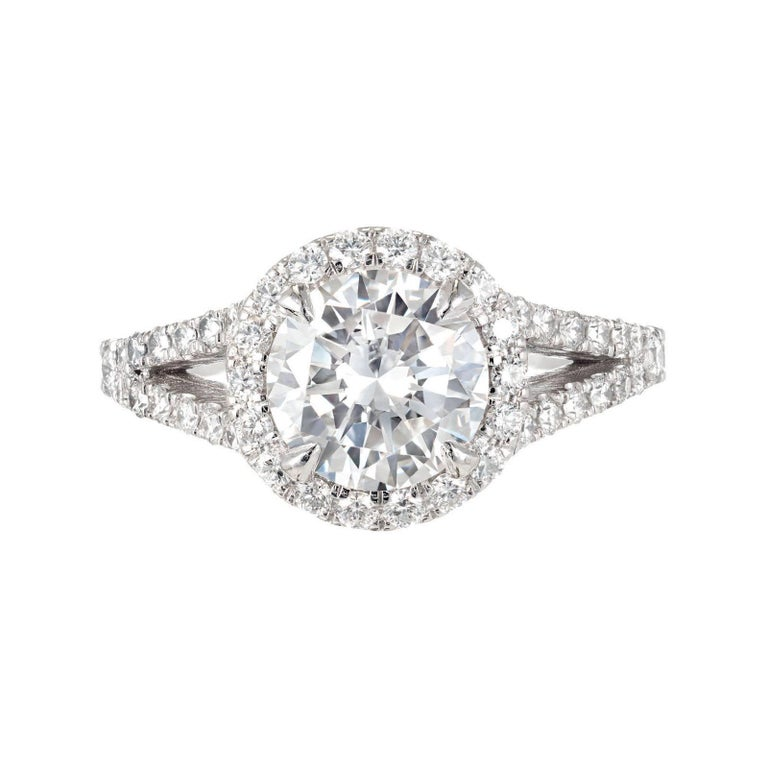 Peter Suchy split shank round Diamond Platinum halo engagement ring. Designed for a wedding band to sit flush to the setting. GIA certified center Diamond 1.55cts.    Platinum 1 round Diamond, approx. total weight 1.55cts, E, VS1, GIA certificate