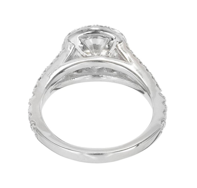 Peter Suchy 1.55 Carat Round Diamond Halo Split Shank Platinum Engagement Ring In Good Condition For Sale In Stamford, CT
