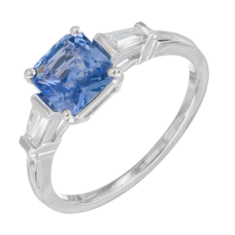 Periwinkle blue Art Deco octagonal step cut 1.55 carat sapphire and diamond engagement setting. The GIA certified center stone is from a 1915 estate. Natural no heat or enhancements. Platinum three-stone setting with two tapered baguette side