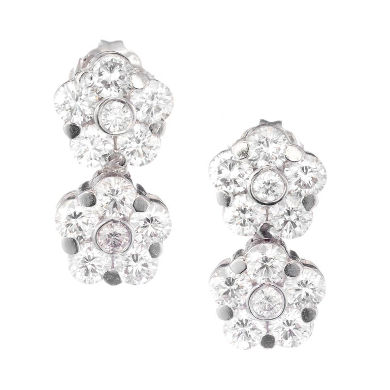 Peter Suchy diamond flower double drop dangle earrings in 18k white gold.  24 round brilliant cut FG VS diamonds, Approximate 2.11 carats  18k white gold  Stamped: 18k 3.4 Grams Top to Bottom: 14.2mm or .56 Inches Width: 7.4mm or .30 Inches Depth or