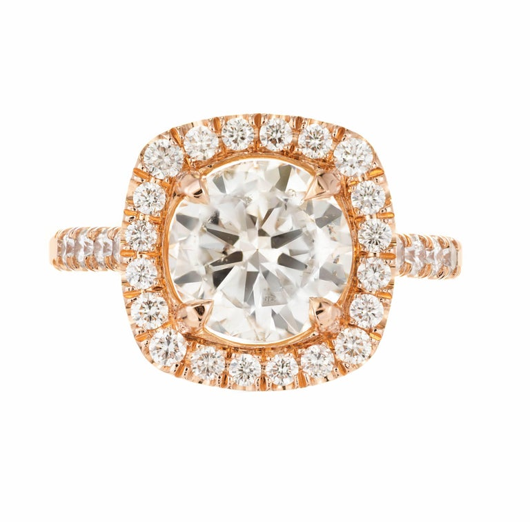 3.04ct transitional Ideal cut diamond halo engagement ring. Slight warm color K that, great sparkle and surface area, no flaws visible to the eye. 18k rose gold setting with diamonds along the shanks.   1 round brilliant cut diamond, approx. total