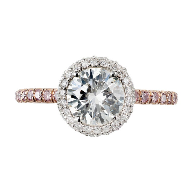 EGL certified diamond engagement ring.  .96cts center stone with a halo of white diamonds in a 18k rose gold setting with pink accent diamonds. Created in the Peter Suchy Workshop.   1 round brilliant cut diamond J VS2, approx. .96ct EGL Certificate
