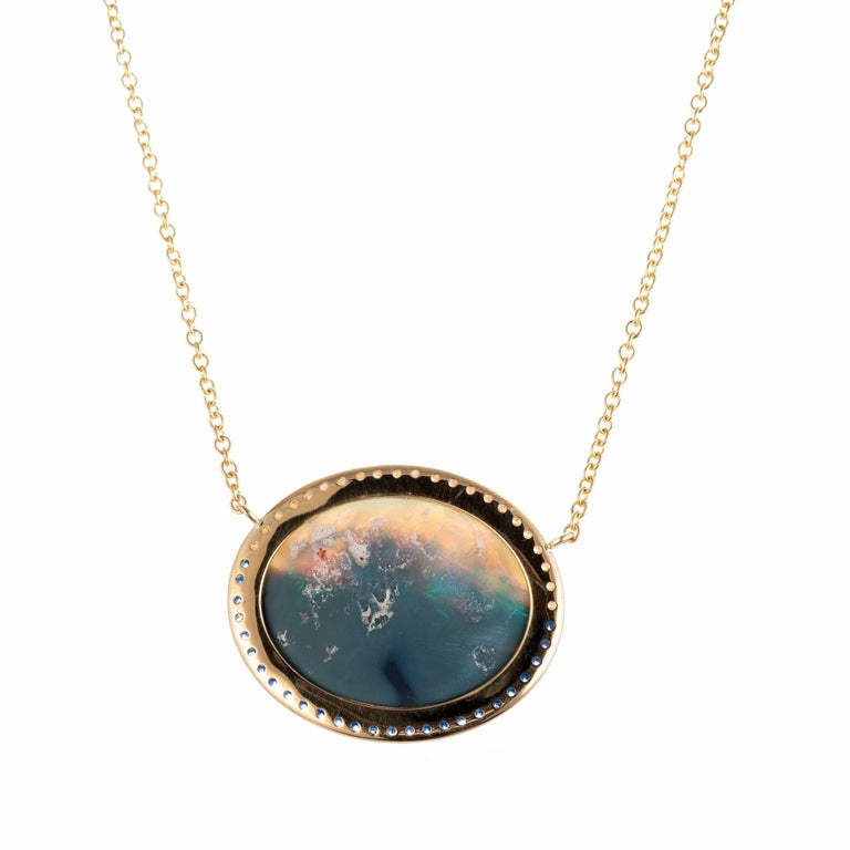 Peter Suchy black Australian opal and diamond pendant necklace. the opal is from an estate Circa 1925. The pendant is designed and made in the Peter Suchy Workshop to show off the natural beauty of the opal. Micro pave blue sapphires and diamonds