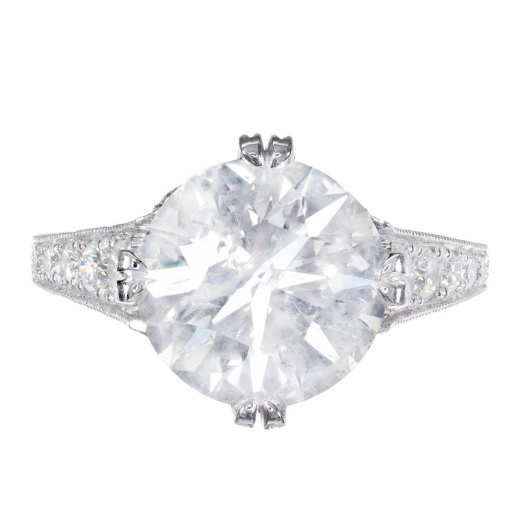 4.87 carat diamond engagement ring. Brilliant cut European diamond center stone, from a 1920's an estate, accented with 14 round diamonds. The platinum setting is a reproduction of the original ring, using old world hand fabrication techniques,