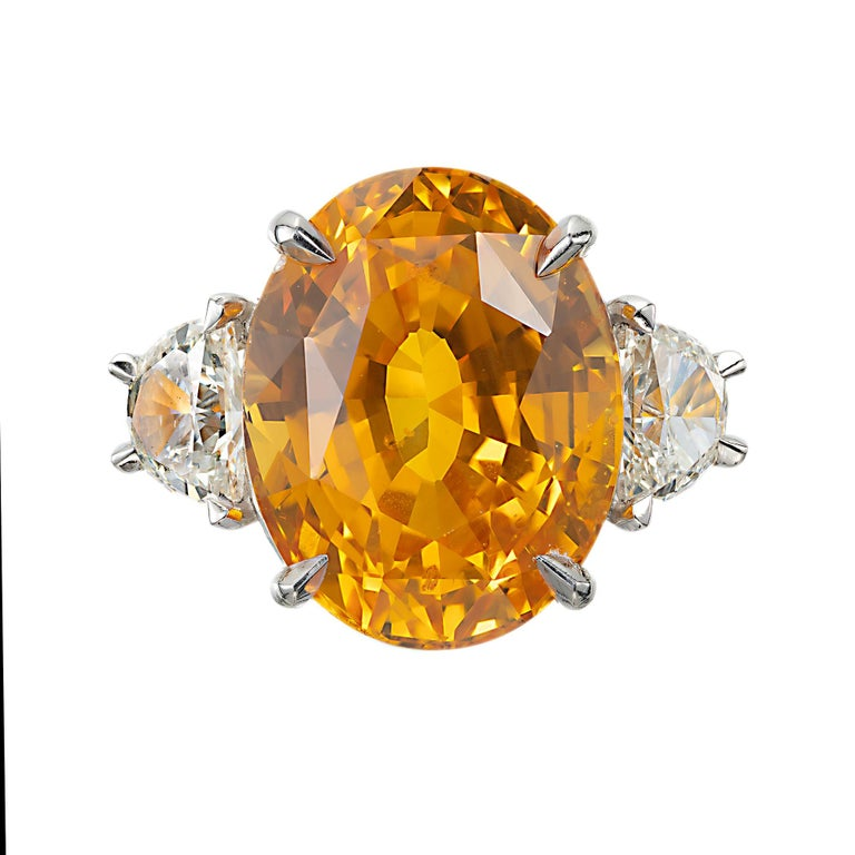 Orange and yellow oval sapphire and half moon diamond cocktail ring. GIA certified center oval center stone in a 18k yellow gold hand made setting with two half moon side diamonds. Crafted in the Peter Suchy Workshop.   1 oval brilliant step cut