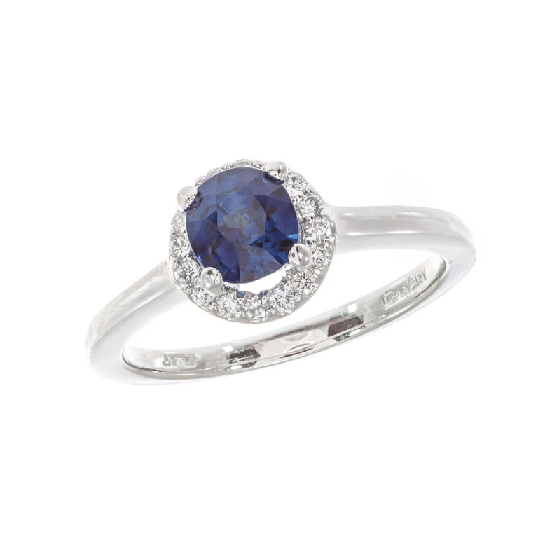 Blue sapphire and diamond engagement ring. GIA certified natural no heat no enhancements center stone in at platinum diamond halo setting. Designed in the Peter Suchy Workshop.   1 cushion cut rich blue SI sapphire Approximate 1.05cts GIA