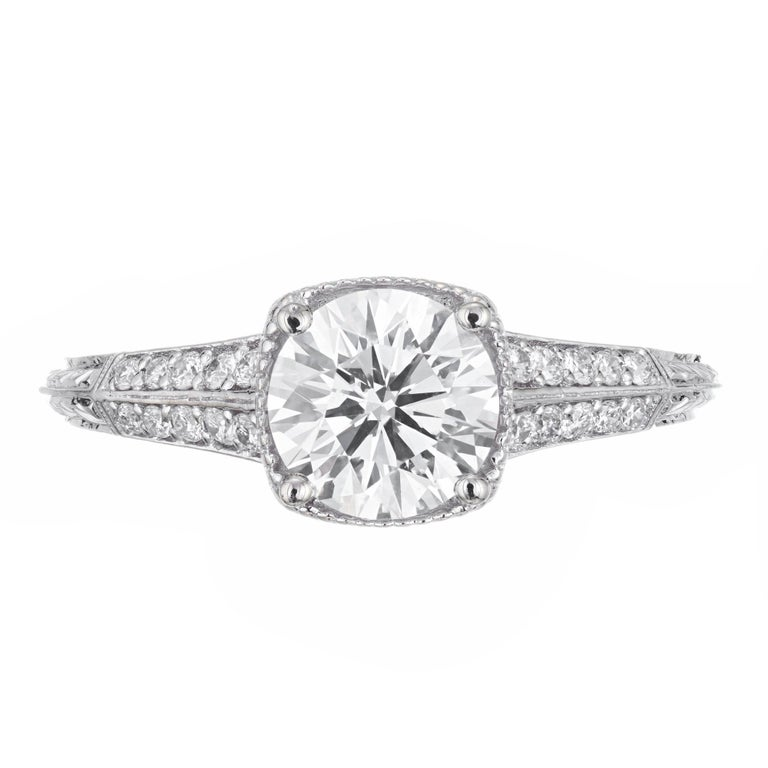 Ideal Brilliant cut diamond engagement ring. GIA certified center stone, set in a 18k white gold setting with 20 round accent diamonds.   1 round diamond, approx. total weight 1.10cts, G, SI1, GIA certificate #2175779159 20 round diamonds, approx.
