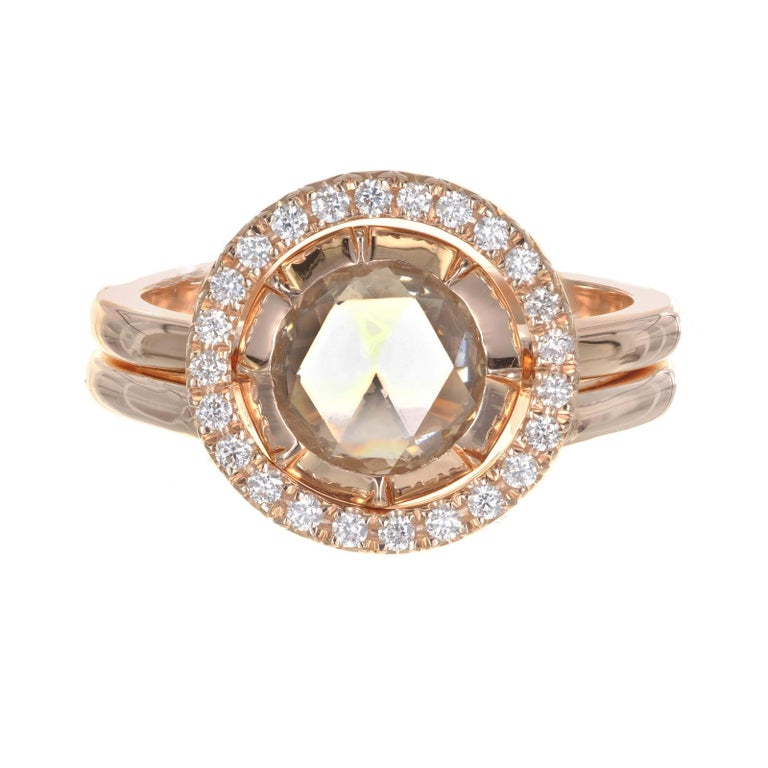 Rose Cut diamond halo engagement ring. GIA certified center diamond with a halo of 24 round diamonds. Two 14k rose gold separate rings. One inserts into the halo ring becoming one. Can be worn as a together or as a solitaire. Designed and created in
