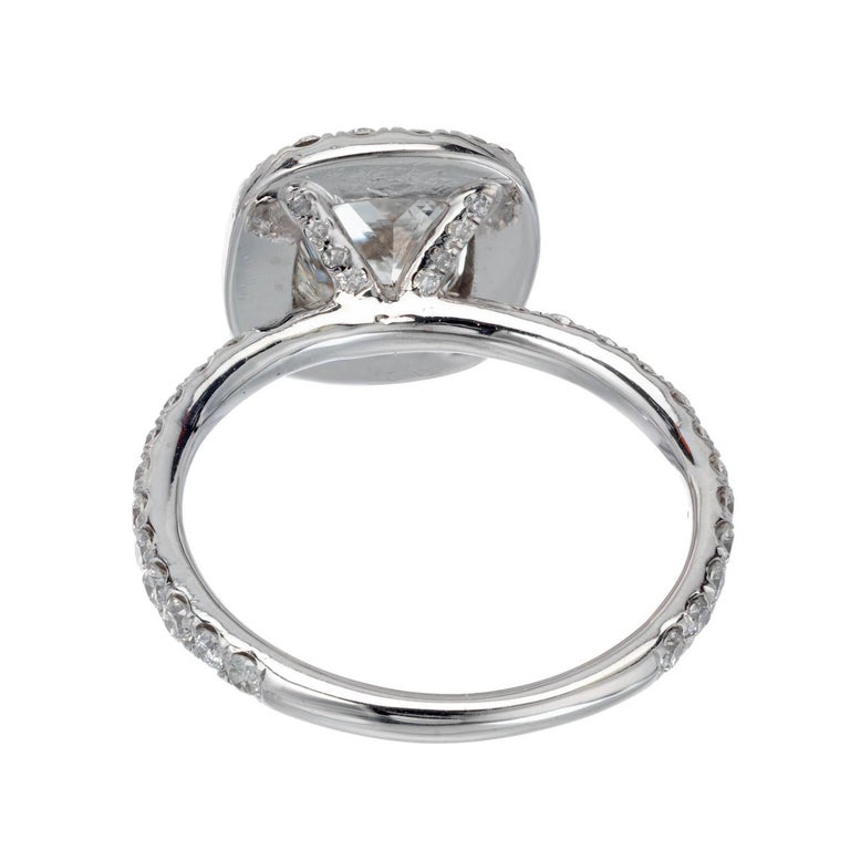 Radiant cut Diamond engagement ring. GIA certified center stone in a custom-made platinum diamond halo setting from the Peter Suchy Workshop. This design allows a wedding band to sit flush.   1 radiant cut cornered rectangular H SI2, approx. 1.64cts