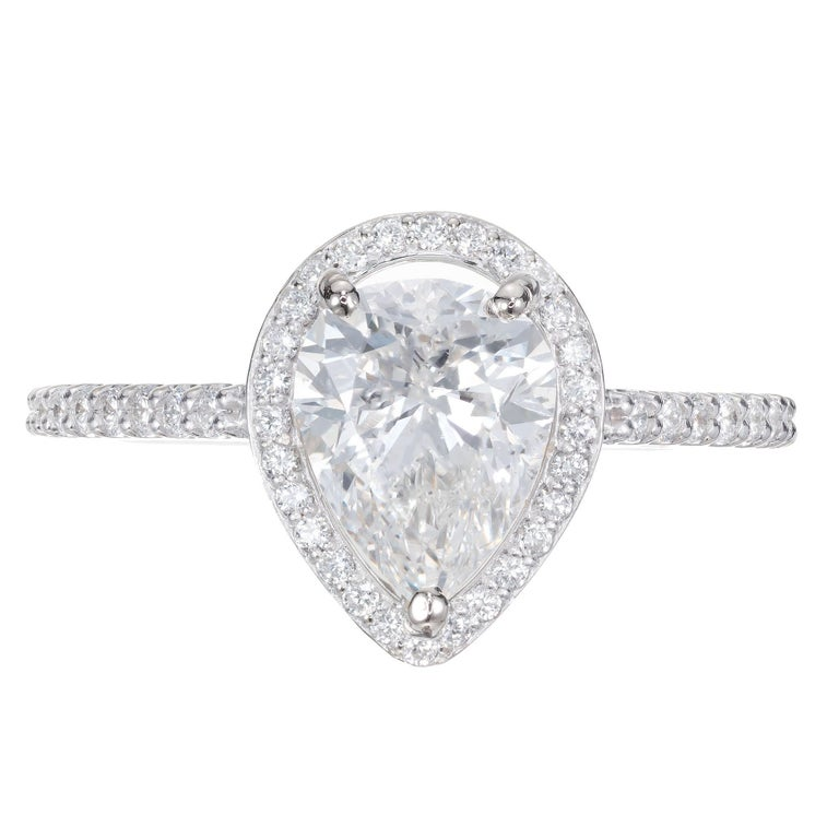 Peter Suchy classic pear shape halo engagement ring. GIA certified center stone with a haolo of 48 round full cut diamonds in a 14k white gold settings.   1 pear shaped Diamond, approx. total weight 1.65cts, J, SI2, GIA certificate #5182332929 48
