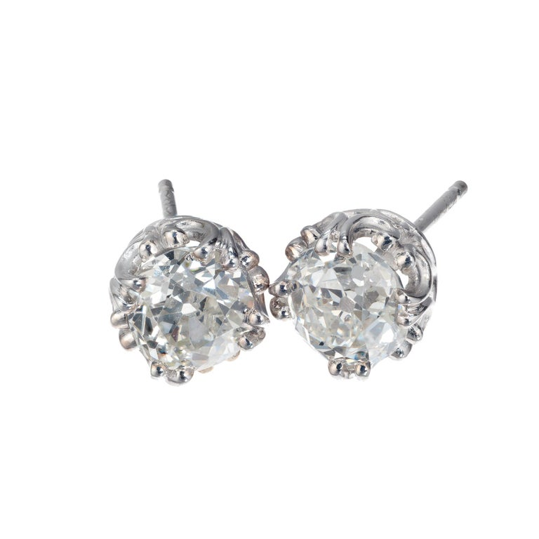 Peter Suchy old mine cut diamond stud earrings with two bright white sparkly estate diamonds in a filigree antique setting.  1 old mine cut K VS diamond, Approximate .82cts GIA Certificate # 1192681402 1 old mine cut I SI diamond, Approximate .98cts