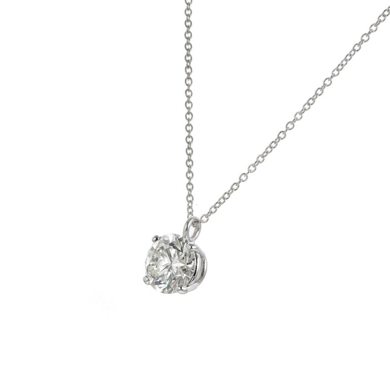 Peter Suchy 2.05 carat GIA certified round Ideal brilliant cut diamond pendant necklace in platinum. 16 inches long.   1 round brilliant cut diamond L SI, approx. 2.05ct GIA Certificate # 5201140880 Platinum  Stamped: PT950 3.7 grams Top to bottom:
