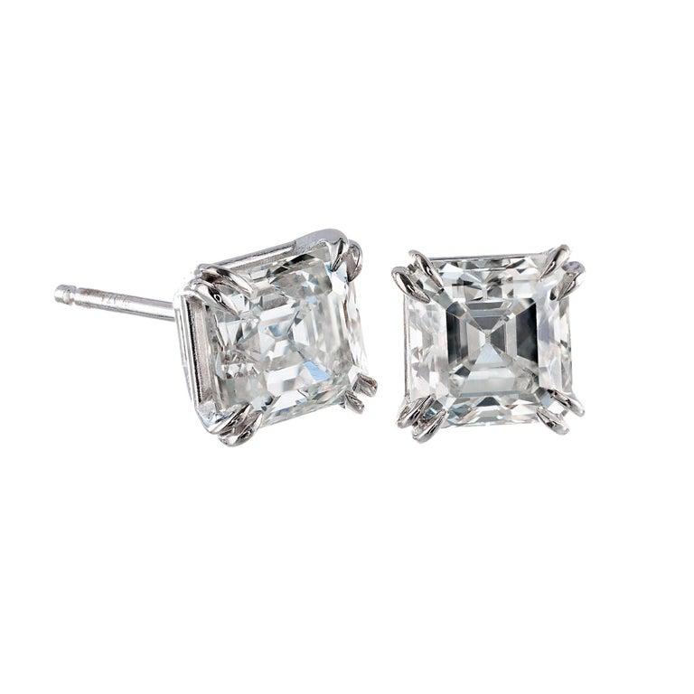 Peter Suchy asscher cut diamond stud earrings. Art deco style custom double prong basket setting in platinum. GIA Certified.    1 asscher cut I SI diamond, Approximate 1.04 carats.  Gia Certificate #6193689188? 1 asscher cut K SI2 diamond,