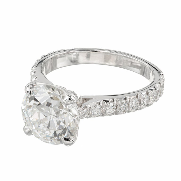 Peter Suchy 3.37 Carat Brilliant Diamond Engagement Ring. GIA certified center stone, set in a platinum setting with 20 round diamonds along the shank.   1 round diamond, approx. 3.37cts HI1 9.35-9.44 x 6.01 mm GIA Certificate # 5202306695 20 round