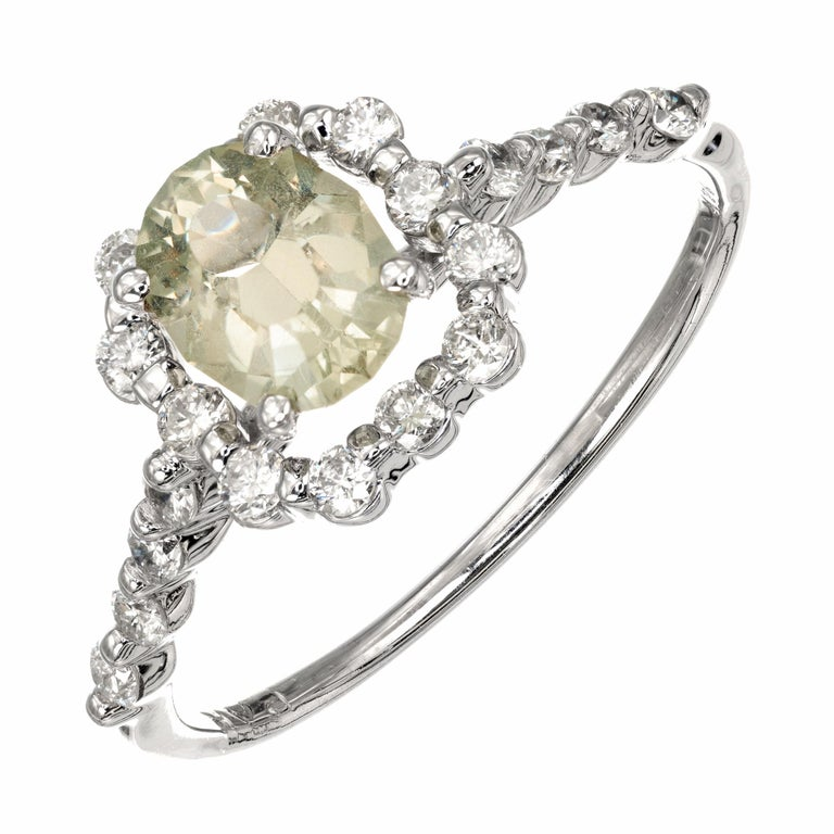 Peter Suchy natural Montana sapphire and diamond engagement ring. The center sapphire is a mix between light yellow and green coloring with a halo of round brilliant cut diamonds. The sapphire is GIA Certified natural no heat. Classic new halo