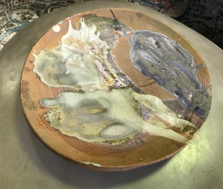 A fantastic, freeform, heavy plate/ charger by American master potter Peter Voulkos who is known for his abstract expressionist ceramic pottery pieces and sculptures. Very unique and scarce work with rare use of color. Very hard to come by. One of