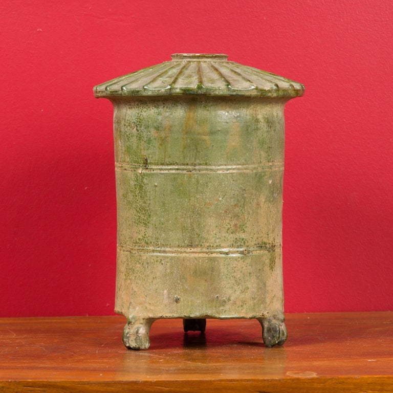 A 17th century Chinese Ming Dynasty granary hand made from terracotta with a verde-gris patina. This miniature of a traditional Chinese granary features a conical top and rests on three small legs. Such items were often placed in graves in order to
