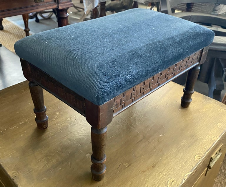 A very charming small antique Louis XV style low blue upholstered carved wood tabouret or foot stool. The stool is covered in a blue canvas like fabric with a velvet look.