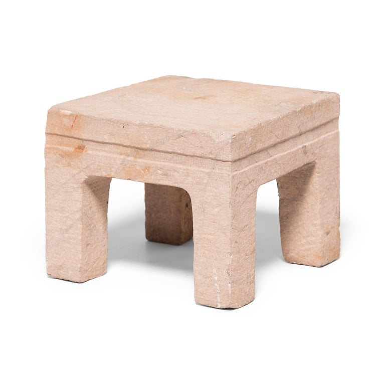 This feng deng, which translates literally to square stool, was hand carved from a solid piece of limestone nearly 250 years ago in northern China. Centuries of use have lent the stone a beautifully worn patina, accentuated by the irregular texture