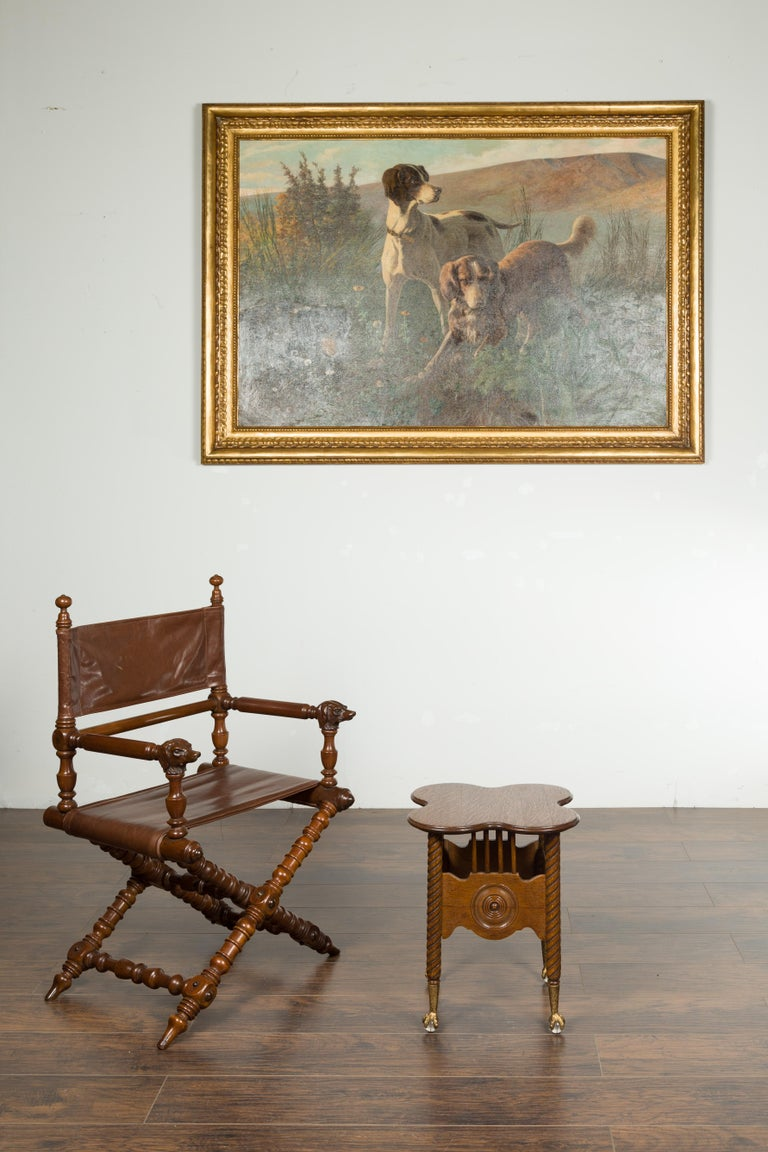 A petite English oak drinks table from the late 19th century, with twisted legs, carved concentric medallions and glass ball and gilt claw feet. Created in England during the last quarter of the 19th century, this petite oak drinks table features a