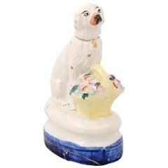Petite English Michael Davis Porcelain Dog with Fruit Basket and Blue Oval Base