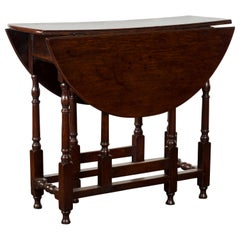 Petite English Oval Oak 19th Century Drop-Leaf Table with Baluster Legs