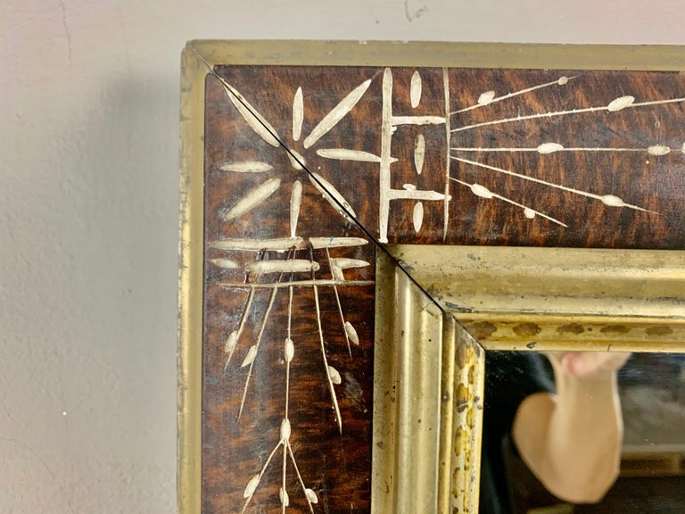 19th century English wood frame with mirror inset. The mirror is decorated with beautiful inlay designs throughout. Giltwood liner with stenciled detailing.