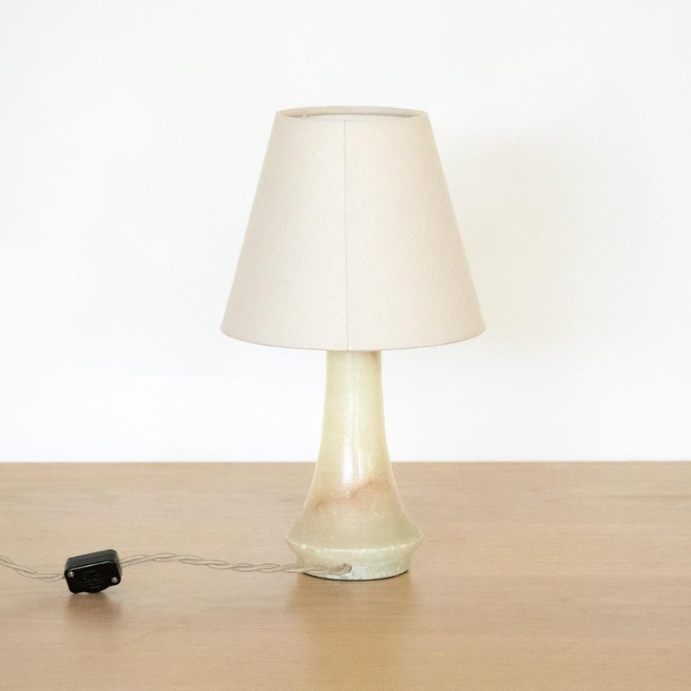 Petite French alabaster table lamp with new oyster linen shade. Newly re-wired.