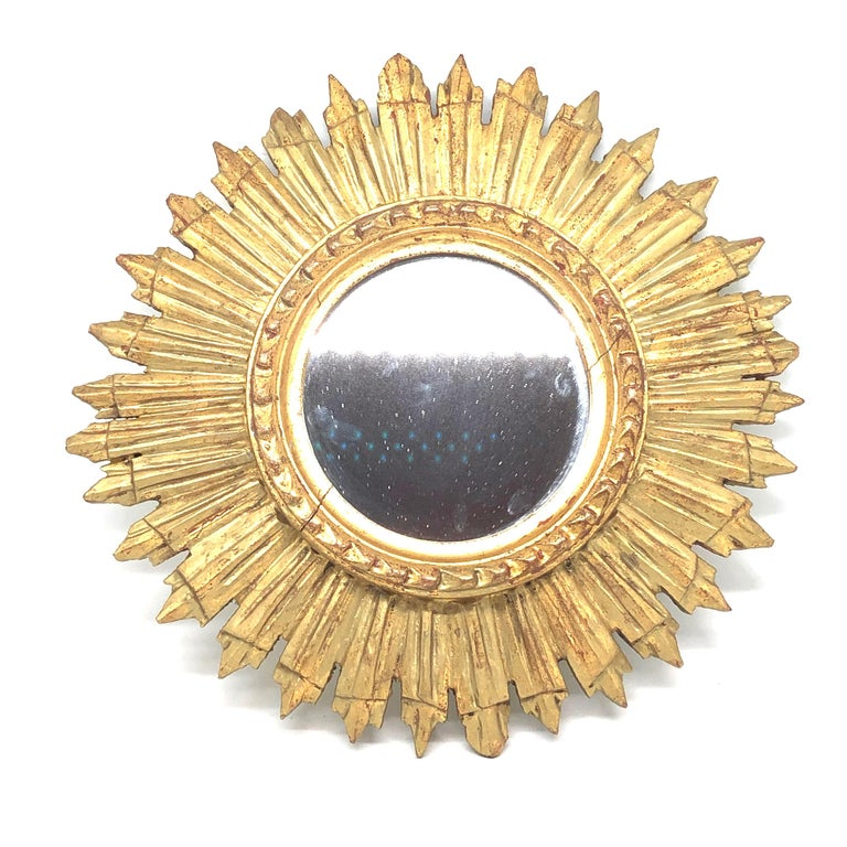 A gorgeous starburst sunburst mirror. Made of gilded wood. It measures approximate 12