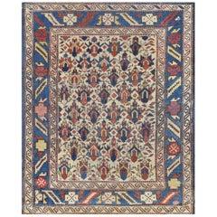 Petite Handwoven Antique Wool Caucasian Rug