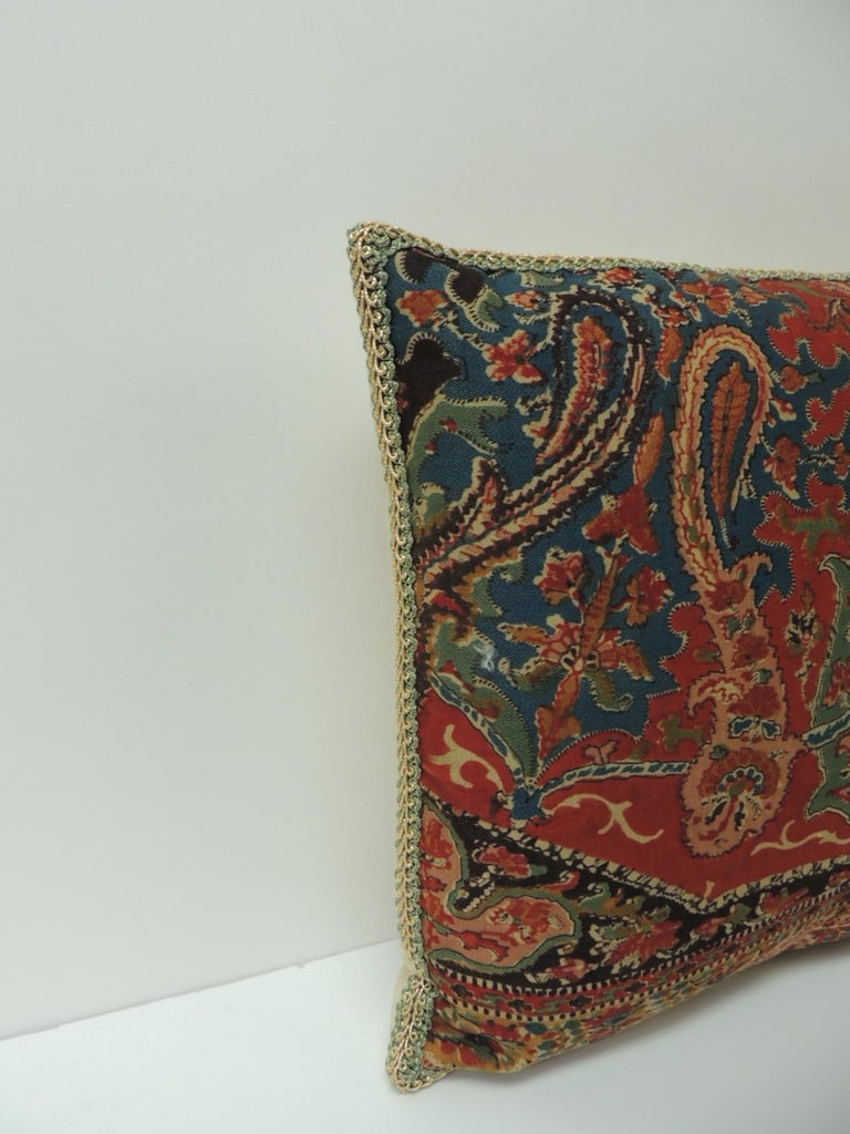 Petite Kashmir paisley silk red textile pillows from India. Sericulture and tweed weaving are one of the major industries in Kashmir. Interestingly, just as little or no raw-material for tweed comes from Kashmir, the same way almost no weaving and