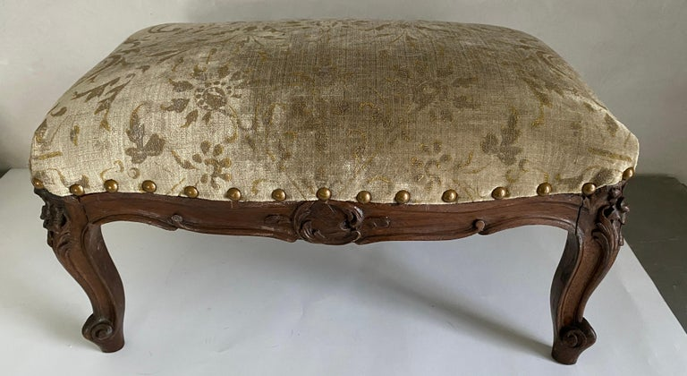 An unusual size, petite and low, this small Louis XV footstool or tabouret, only 10