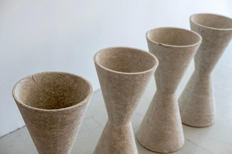 Smaller in size but large in style. Willy Guhl concrete pots.