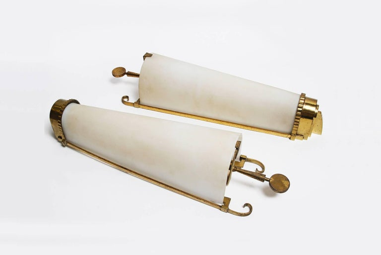 Ets Petitot Important pair of gilt bronze, gilt iron and frosted glass sconces, France, circa 1930. Stamped PETITOT on the frame. Not rewired yet, two original sockets and lightbulbs. Will be re-wired with no additional costs. Measures: H 22