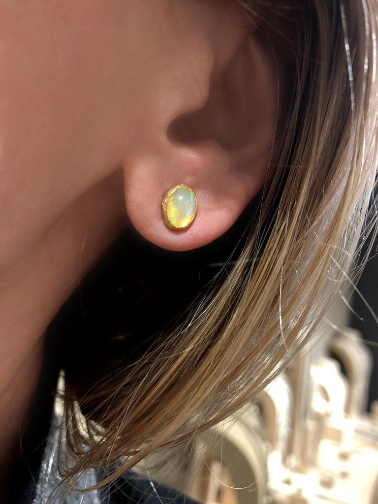 Artist Petra Class Fiery Oval Ethiopian Opal Petite Gold Stud Earrings For Sale