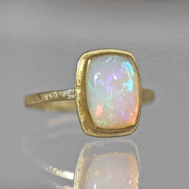 Artisan Petra Class Fiery Rainbow Ethiopian White Opal Cabochon Framed Matte Gold Ring For Sale