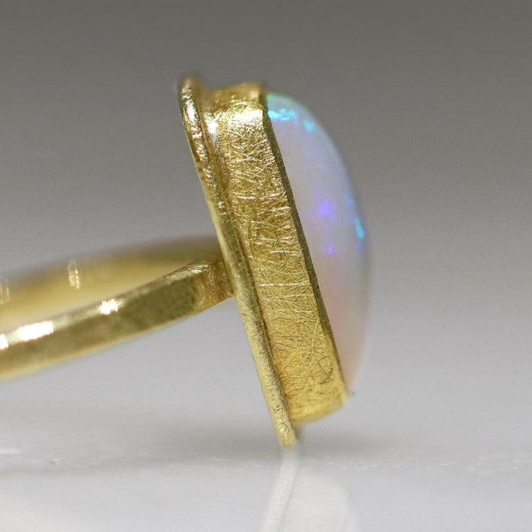 Cushion Cut Petra Class Fiery Rainbow Ethiopian White Opal Cabochon Framed Matte Gold Ring For Sale