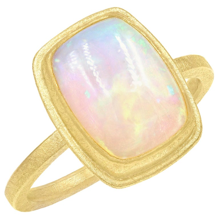 Petra Class Fiery Rainbow Ethiopian White Opal Cabochon Framed Matte Gold Ring For Sale