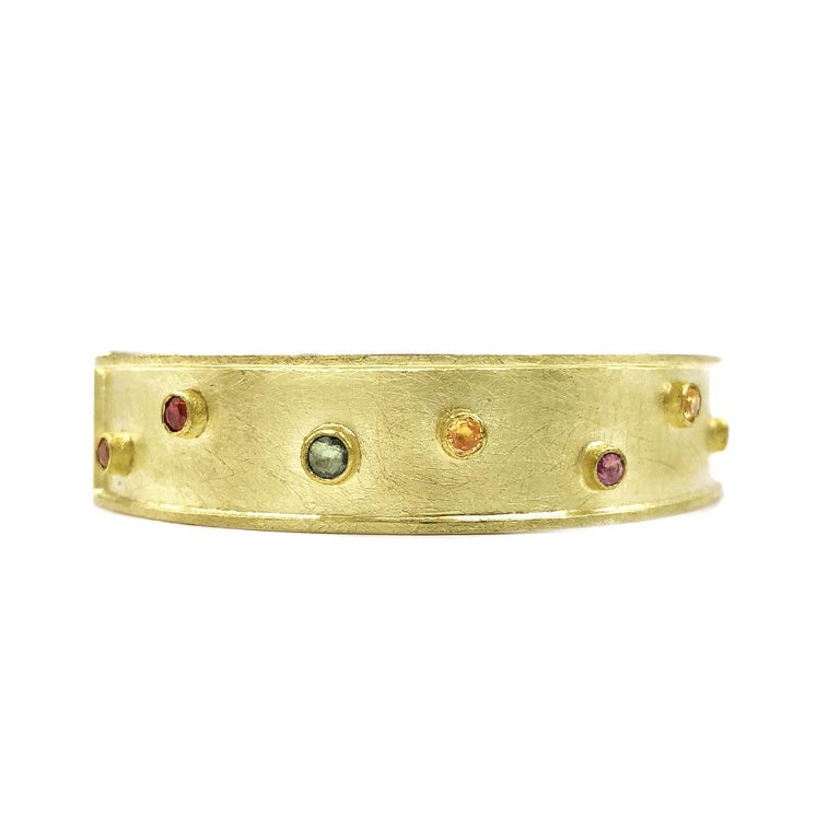 One of a Kind Dots Bracelet handcrafted by acclaimed jewelry maker Petra Class in a combination of signature-finished 22k yellow gold and 18k yellow gold featuring 2.50 total carats of assorted faceted round multicolored sapphires. 12mm width.