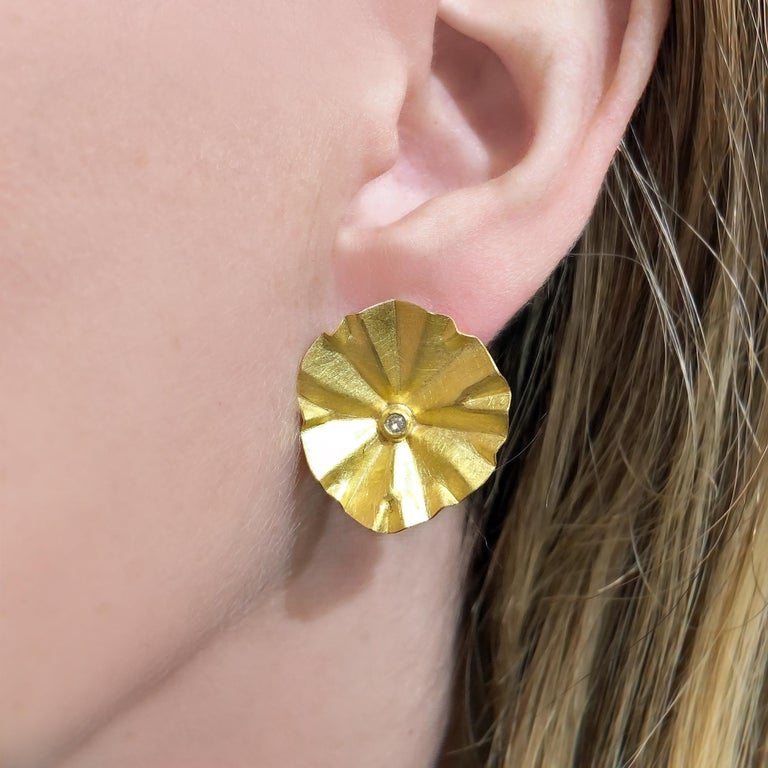 Large Gold Lotus Ruffle Earrings handcrafted by acclaimed jewelry maker Petra Class in lustrous, finely-textured 22k yellow gold accented with rounded brilliant-cut white diamonds and finished on 18k gold posts with large backs. Stamped and