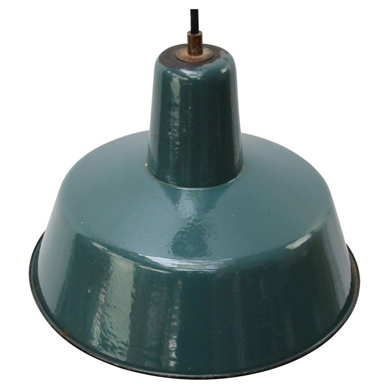 Vintage industrial pendant. Petrol enamel with white interior.