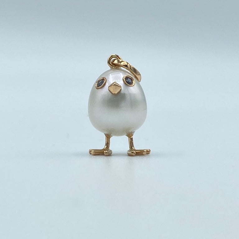 Chick Australian Pearl Diamond Yellow Red white 18 Kt Gold Pendant  Necklace A oval shape Australian pearl has been carefully crafted to make a chick. He has his two legs, two eyes encrusted with two black diamonds and his beak.  The gold is
