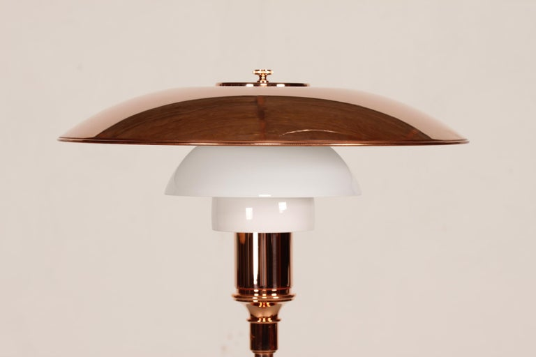 PH 3½ - 2½ anniversary floor lamp limited edition 2016, designed by Poul Henningsen (1894-1967). Manufactured by Louis Poulsen A/S on the occasion of the 90th year anniversary of PH´s three-part shade system.   The lamp base is made of cobber. The