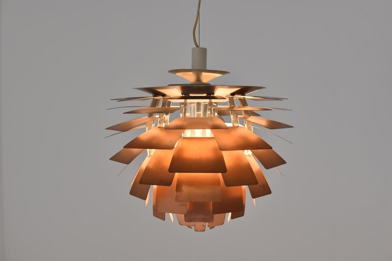 First edition PH Artichoke pendant by Poul Henningsen for Louis Poulsen, Denmark, 1950s. This iconic pendant is constructed from copper, enameled steel, chrome plated brass and enameled aluminium. It is designed in 1958 for Langelinie Pavillionen in